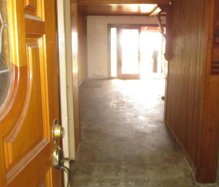 Completely clean entry and hallway after packing customer contents and removal of damaged items