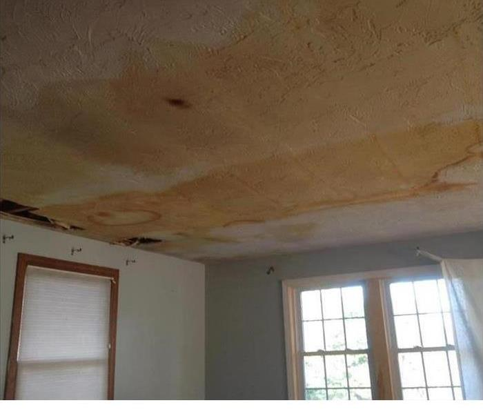 water damaged ceiling showing staining