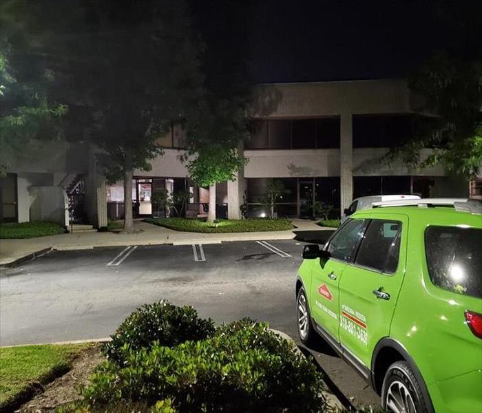 SERVPRO vehicle in front of a building at night