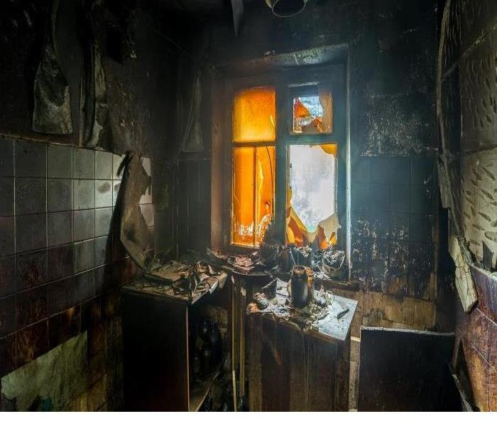 Fire damaged house and broken window