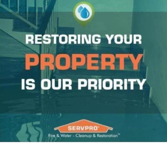 Words: Restoring your property is our priority in orange and white lettering with a green background